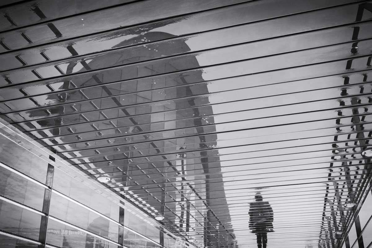 Reflections of a walker in Valencia