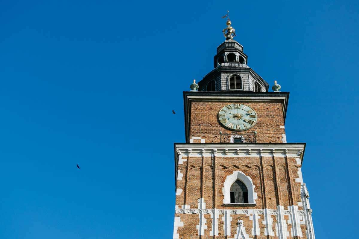 Photo of a church bell tower against a blue square