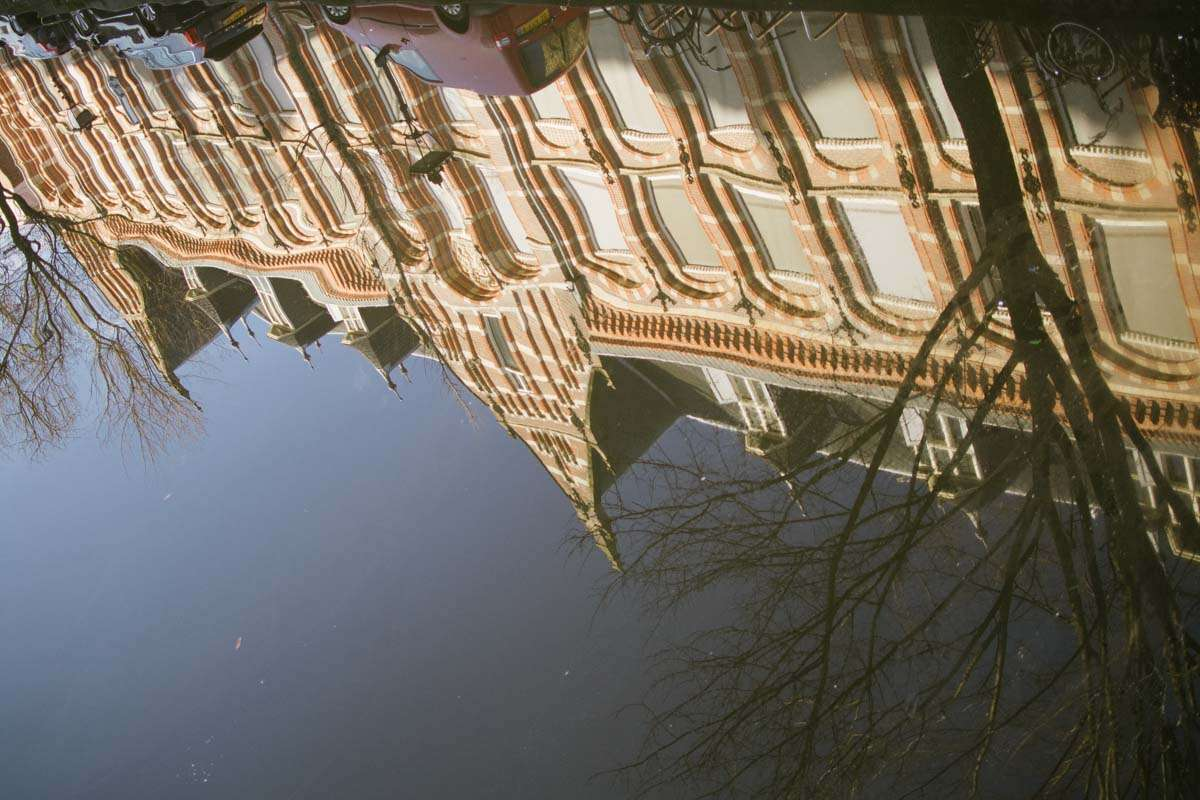 reflection of a building in a dutch canal