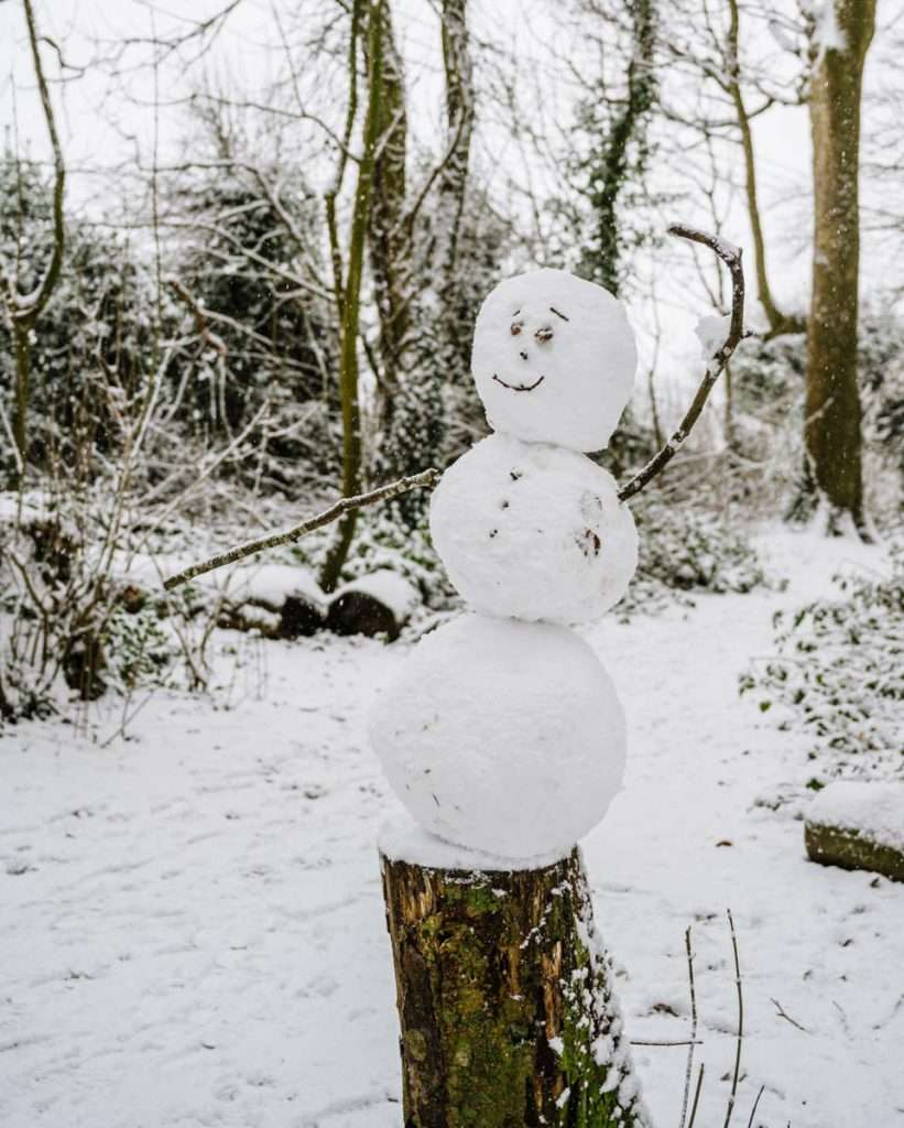 A snowman giving traffic directions, Sonning Common near the sports field