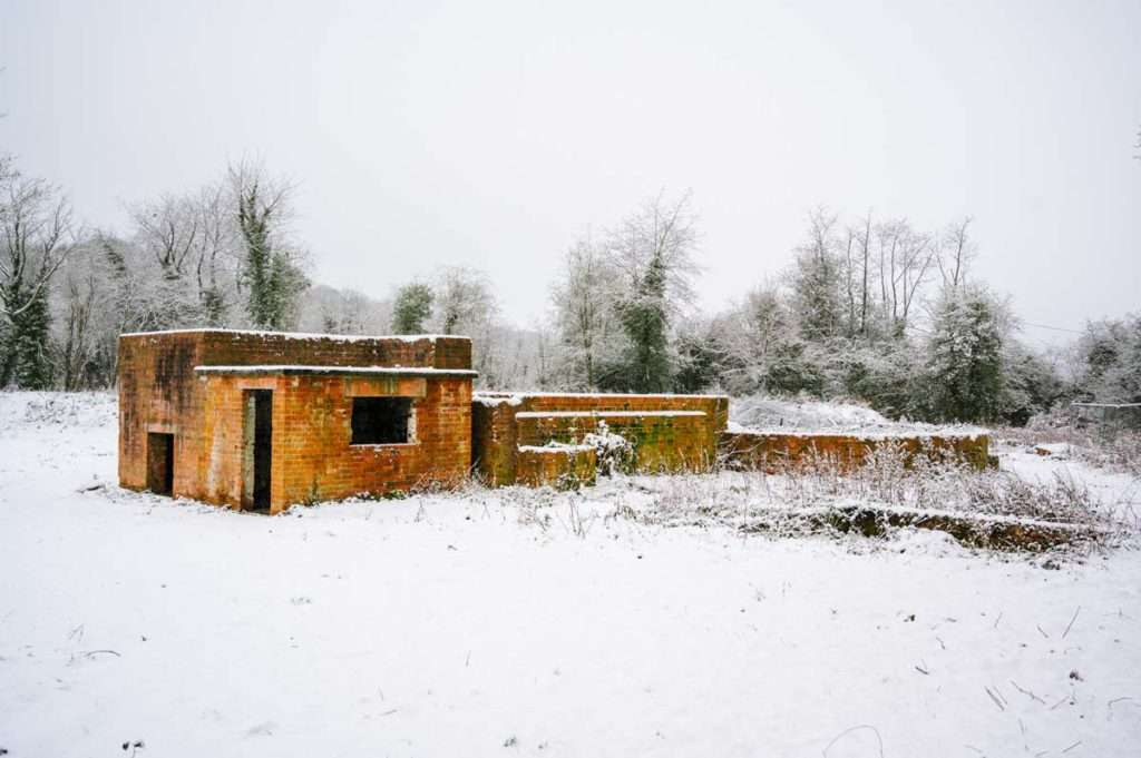 A photograph of a derelict Bombshelter at the former Bishopwood Camp